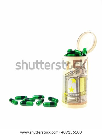 Expensive cost of medical cover , healthcare and treatment concept with green capsules filling and around a plastic pharmacy container wrapped in a 50 euro banknote - stock photo