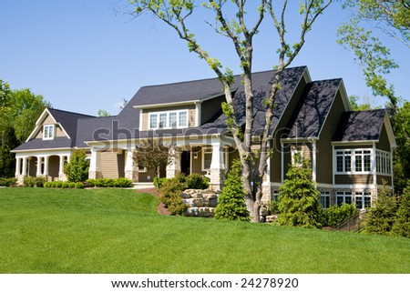 Expensive Home Against a Blue Sky - stock photo