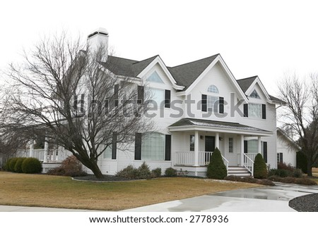 Expensive white two story house - stock photo
