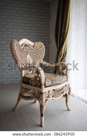 expensive wicker chair near the window - stock photo