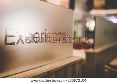 Experience concept text on glass, vintage style - stock photo
