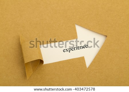 experience written under torn paper. - stock photo
