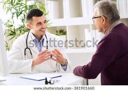 Experienced doctor and patient, medic concept - stock photo