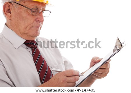 Experienced engineer looking to the clipboard (isolated on white) - stock photo