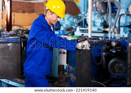 experienced factory worker working in gum boot factory - stock photo