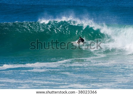 experienced surfer doing a turn on breaking wave