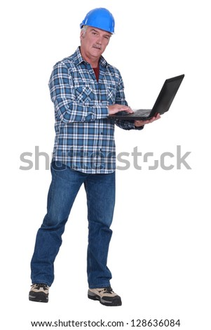 Experienced tradesman embracing technology - stock photo