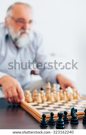Experienced white against the black - stock photo