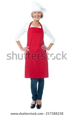 Experienced woman chef with hands on her waist - stock photo