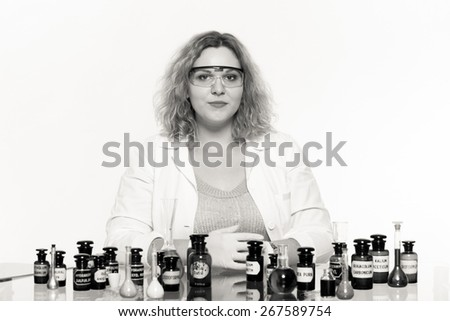 Experiment, research in progress. Chemist woman or student girl, laboratory assistant or scientific researcher with chemical glassware test flask - stock photo