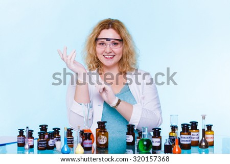 Experiment, research in progress. Chemist woman or student girl, laboratory assistant or scientific researcher with chemical glassware test flask on blue