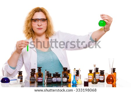 Experiment, research in progress. Chemist woman or student girl, laboratory assistant or scientific researcher with chemical glassware test flask. Isolated on white - stock photo