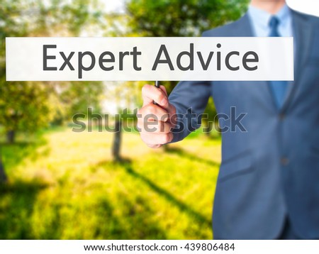Expert-Advice - Businessman hand holding sign. Business, technology, internet concept. Stock Photo - stock photo