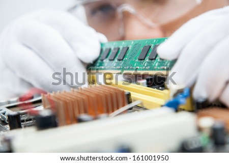Expert engineers examining computer equipment.