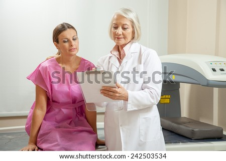 Expert female doctor explaing medical test to female patient in 40s. - stock photo