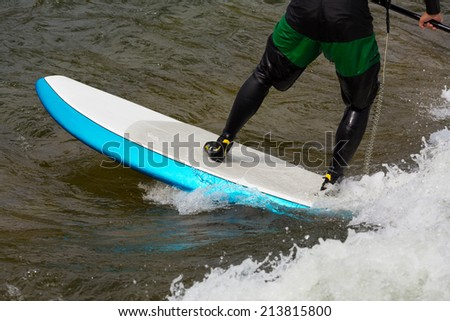 Expert male sportsman on stand up paddle board in the rapids of River Arkansas at Buena Vista in Colorado - stock photo