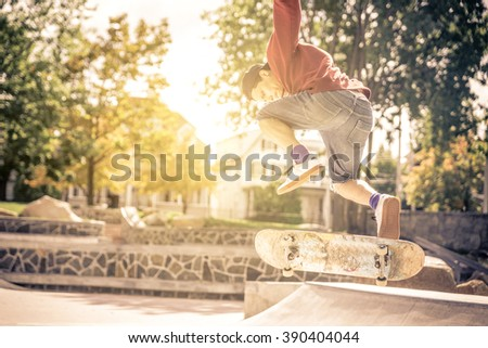 Expert skateboarder performing tricks in a skate park. concept about sport  - stock photo