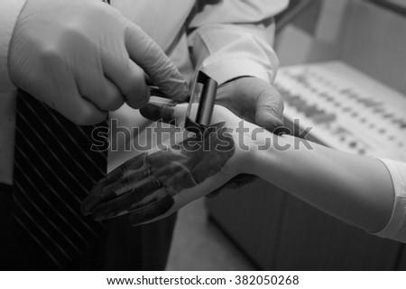 Expert takes fingerprints. investigation of the crime. - stock photo
