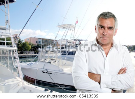 expertise captain of fisherman boat in caribbean tropical marina [Photo Illustration] - stock photo