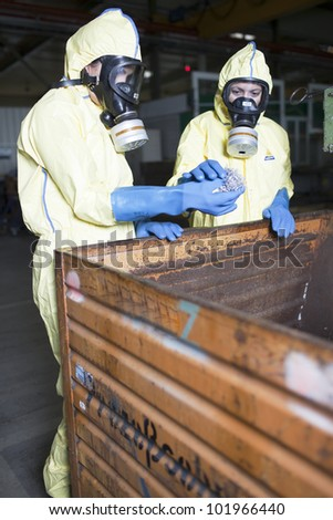 Experts analyzing infested material - stock photo