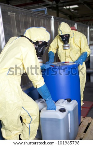 Experts disposing infested material - stock photo