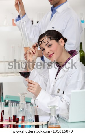 experts testing wine in a laboratory - stock photo