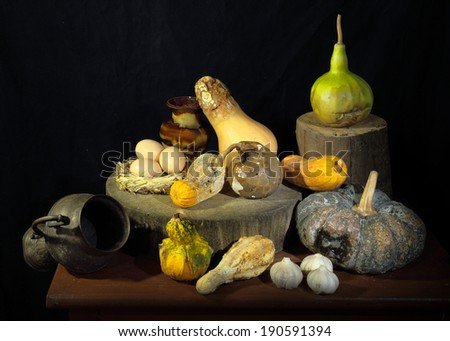 Expired pumpkins with garlic eggs as still life art photography - stock photo