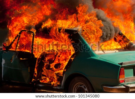 Exploded parking car on fire - stock photo