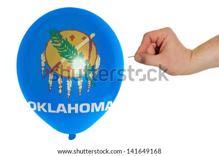 exploding balloon colored in flag of us state of oklahoma - stock photo
