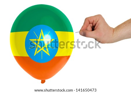 exploding balloon colored in national flag of ethiopia