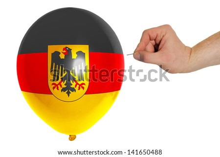 exploding balloon colored in national flag of germany - stock photo