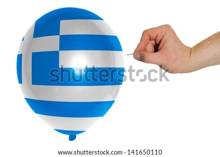 exploding balloon colored in national flag of greece - stock photo