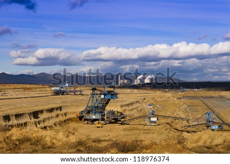 Exploitation of quarries, sunny day. - stock photo