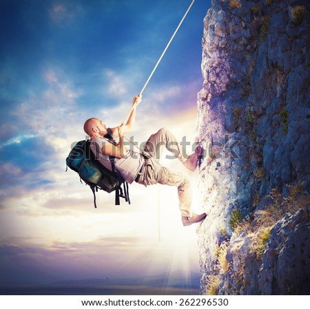 Explorer and his passion for climbing mountains - stock photo