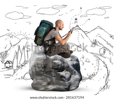 Explorer in the mountains browse the network - stock photo