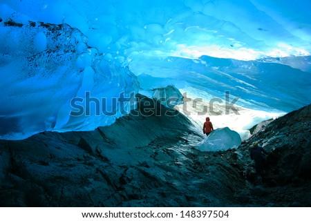 Explorer Inside Ice Cave, Mendenhall Glacier, Juneau, Alaska, USA - stock photo