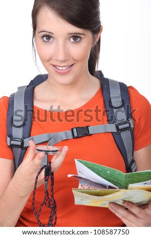 Explorer looking at her compass - stock photo