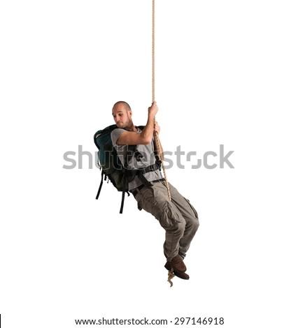 Explorer with vertigo hanging from a rope - stock photo