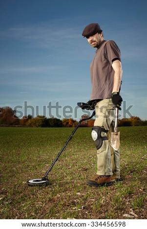Exploring autumn field for metal - stock photo