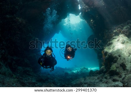 Exploring the caves at St John's, Red Sea, Egypt - stock photo
