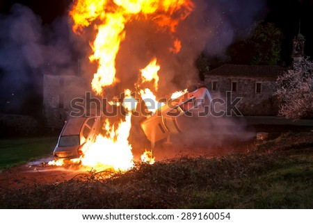Explosion controlled two vehicles, during the filming of a movie - stock photo