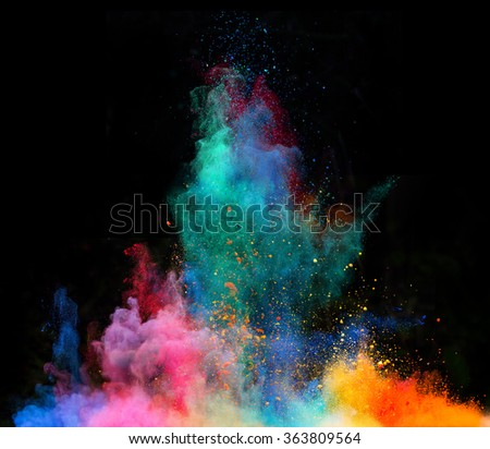 Explosion of colorful powder, isolated on black background - stock photo