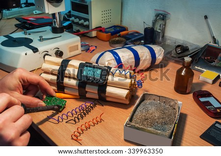 explosives (timebomb) maker in workshop - stock photo