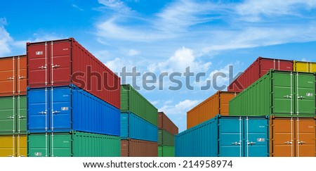export or import shipping cargo containers stacks in port under sky - stock photo