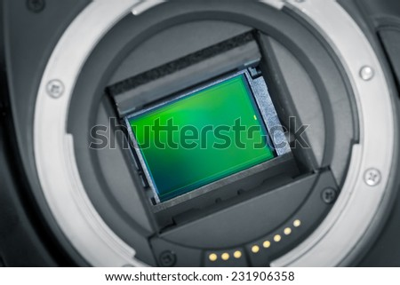 Exposed APS-C image sensor, mirror lifted up. - stock photo