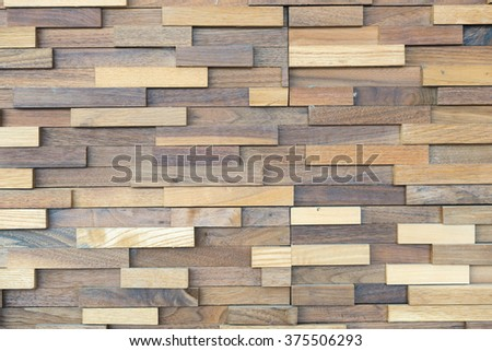 exposed wooden wall exterior, patchwork of raw wood forming a beautiful parquet wood pattern