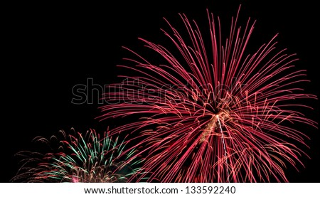 Exposure of multiple fireworks with a black sky. - stock photo