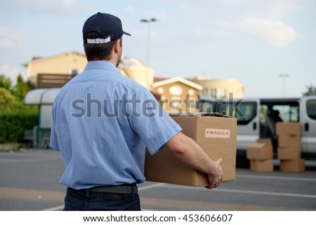 Express courier delivering a box