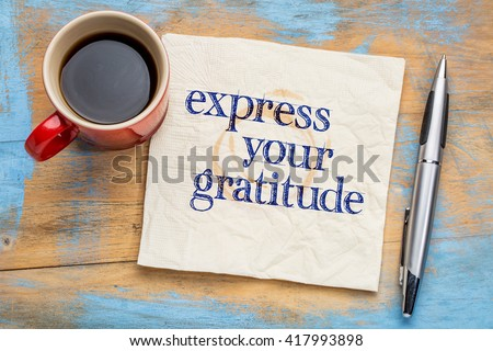 Express your gratitude - handwriting on a napkin with a cup of coffee - stock photo