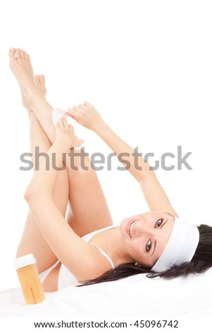 Expression woman depilating her legs - stock photo